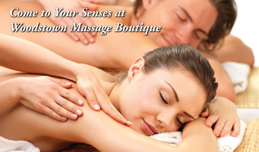 photo of couple getting massage together
